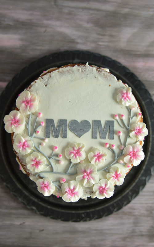 mother's day cake decorated with buttercream cherry blossoms