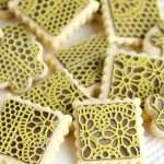 square cookies decorated with chocolate lace