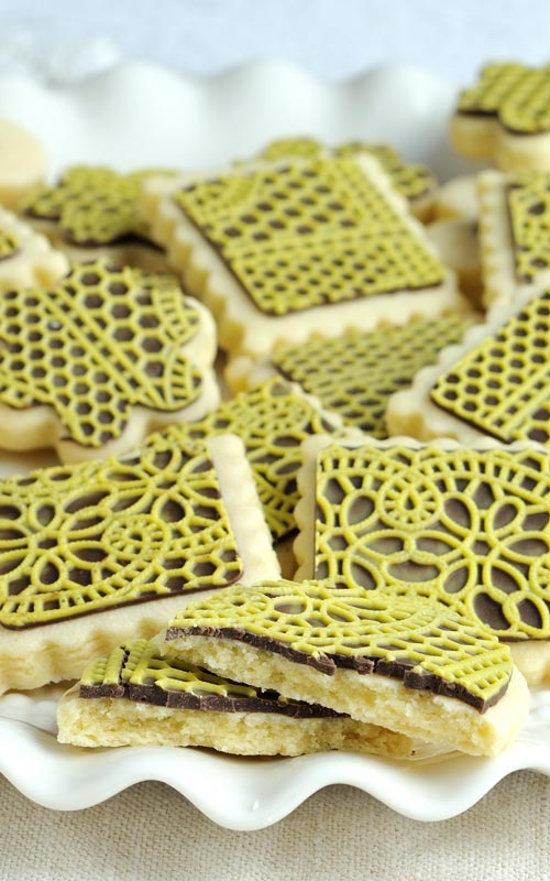 cookies decorated with two tone chocolate lace