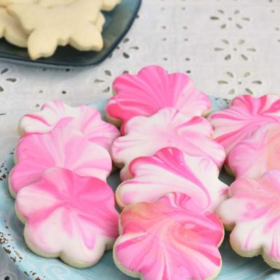 Pink marbled gluten free sugar cookies on a plate.