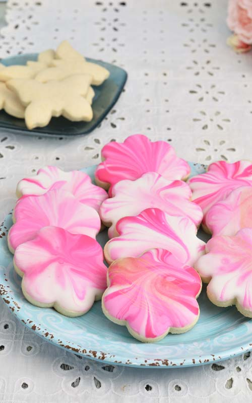 pink marbled gluten free sugar cookies on a plate