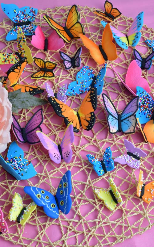 beautiful colorful royal icing butterfly display