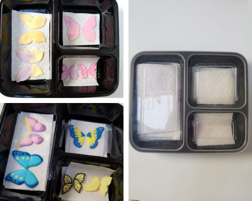 Royal icing decorations in a plastic container