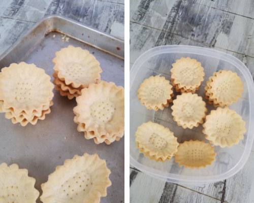 baked mini tart shells in a container
