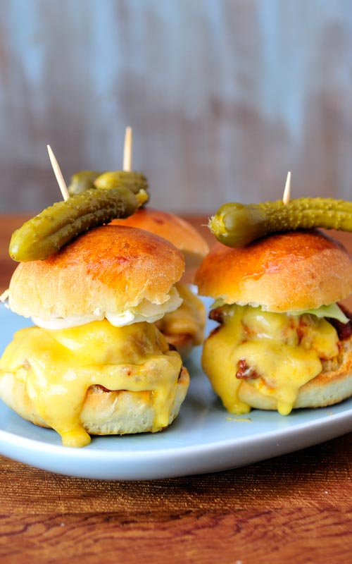 Slider with chicken bacon meatballs and a pickle on the top.