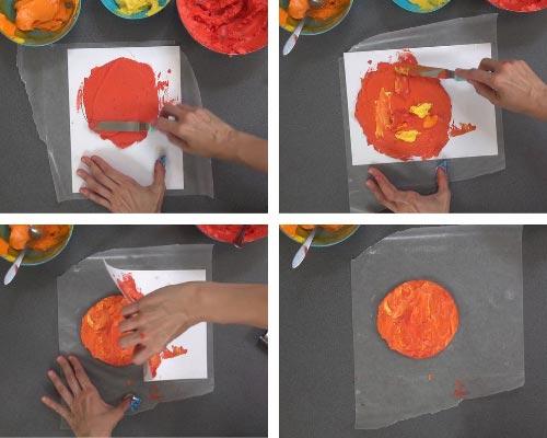 Buttercream spread over a stencil, making buttercream transfer for a cake.