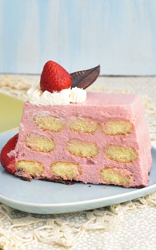 Slice of a strawberry mousse cake.