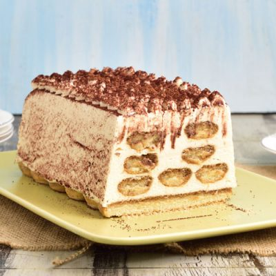 Baileys tiramisu cut on a serving dish.