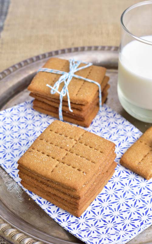 Stacked homemade graham crackers on a tray.