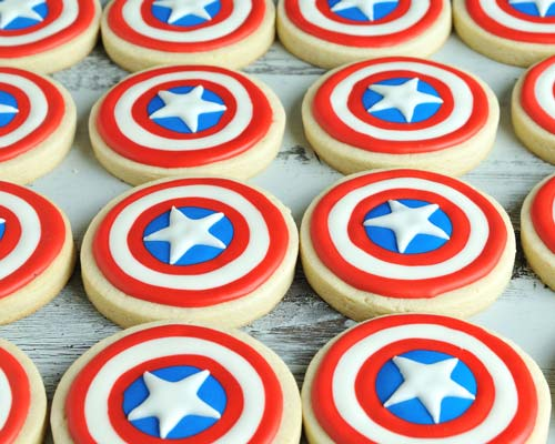 Round Captain America Shield Cookie decorated with blue red and white royal icing.