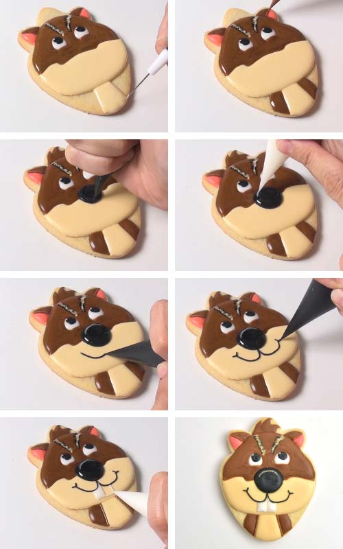 Decorating chipmunk cookie. Piping a neck, nose and a month with royal icing.