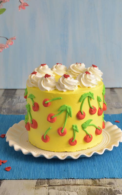 Cake decorated with cherry pattern.