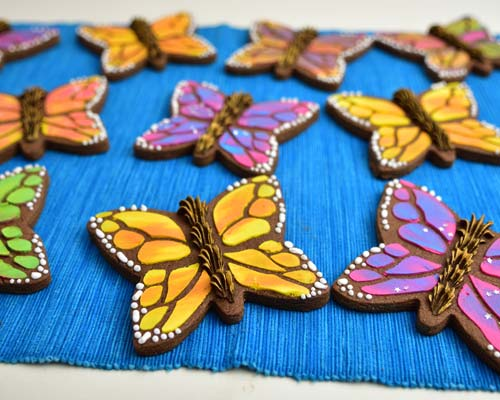 Monarch butterfly cookies on a blue background.