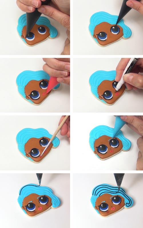 Drawing an nose on royal icing with an edible marker.