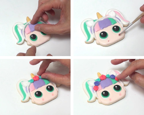 Attaching royal icing transfers on a cookie.