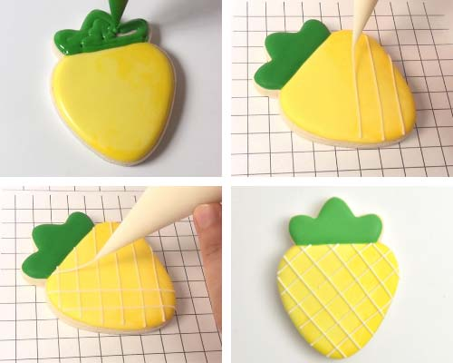 Piping straight lines across a pineapple cookie iced with yellow icing.