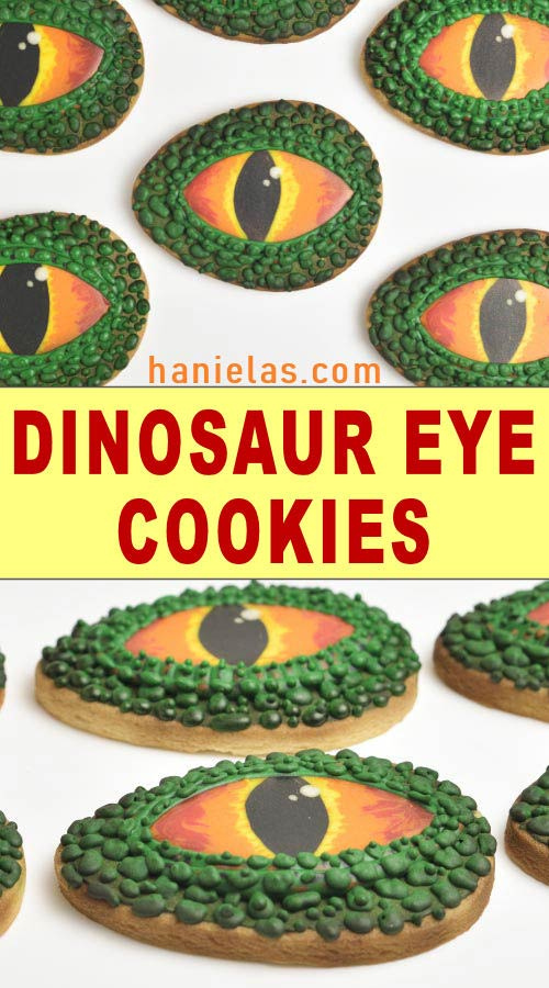 Decorated cookies that look like dinosaur eyes on white background.