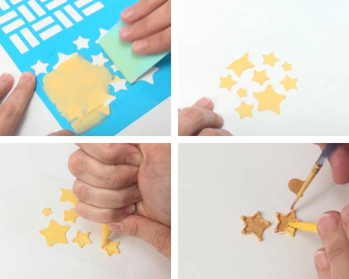 Spreading royal icing over a star stencil.