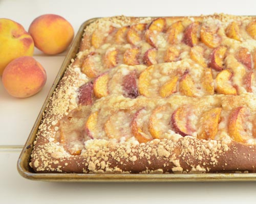 Baked peach slab bread in a baking pan.