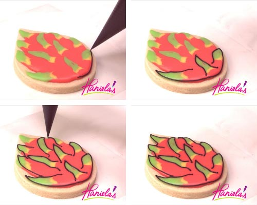 Outlining dragon fruit decorated sugar cookie with a black outline.