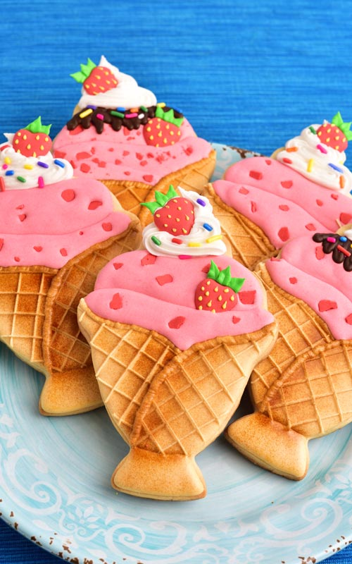 Decorated strawberry ice cream sundae cookies on a plate.