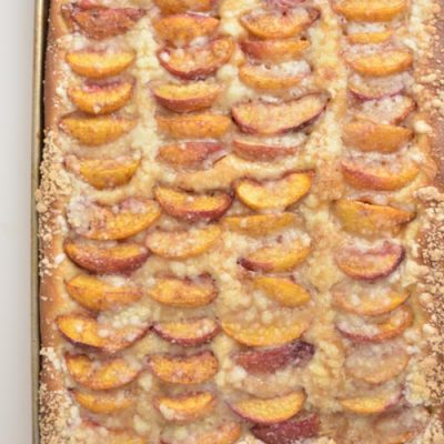 Baked peach streusel bread in a baking pan.