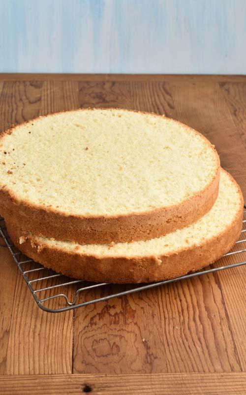 Sliced sponge cake on a cooling rack.