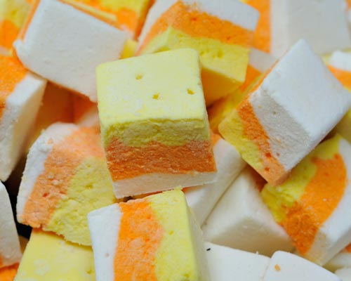 Multi colored layered marshmallow cubes.