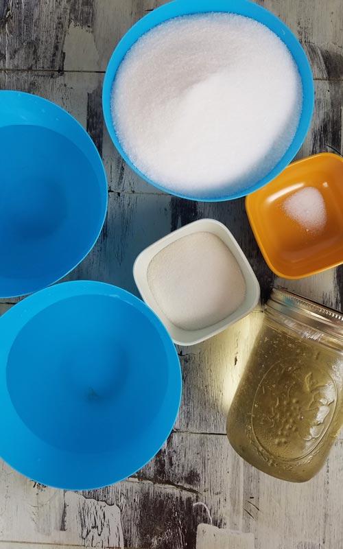 Water, sugar, gelatin, salt and invert sugar in bowls.