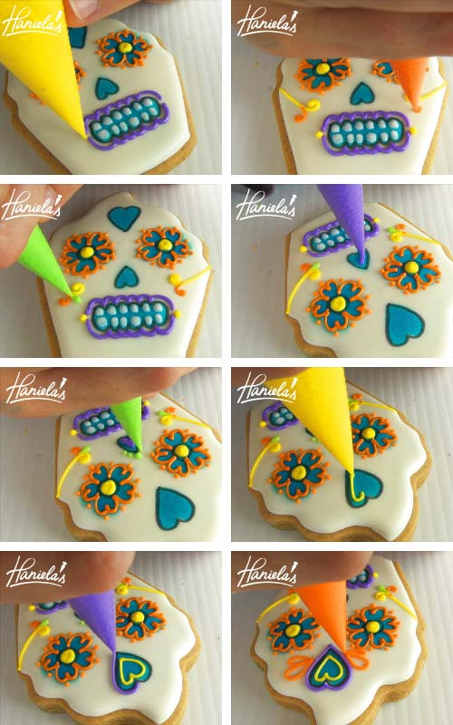 Piping nose, swirls and hearts with royal icing on a cupcake cookie.