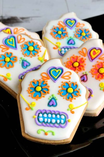 Decorated cupcake cookies that look like skulls.
