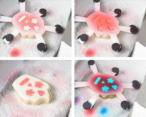 Airbrushing cookie with card stock template.