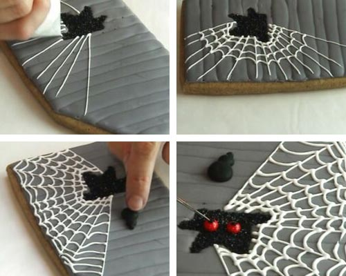 Piping white spider web onto a cookie.