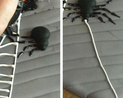 Piping black spider with royal icing.