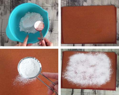 Dusting large cutting board with powdered sugar and corn starch.