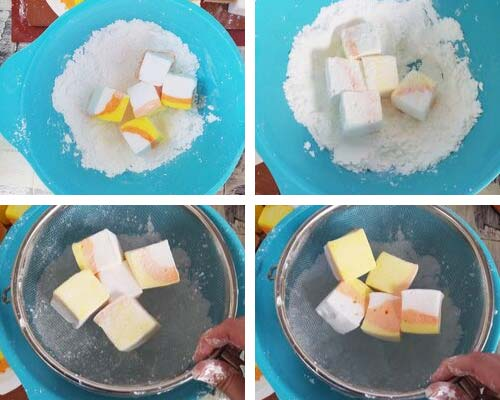 Coating fresh marshmallows with powdered sugar and corn starch.