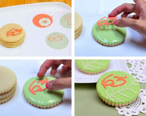 Applying royal icing transfer onto wet royal icing.