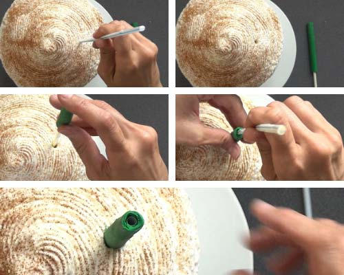 Making a hole in the cake with a drinking straw and inserting green fondant drinking straw into the cake.