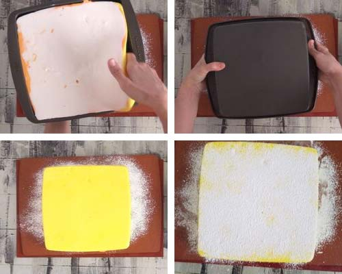 Unmolding marshmallow slab onto a cutting board dusted with powdered sugar and corn starch.