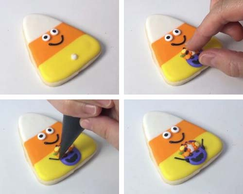 Attaching royal icing basket decoration on a candy corn cookie.