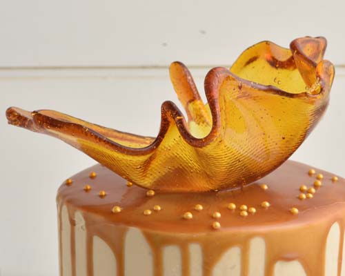 Detail of caramel sail decoration on top of the cake.