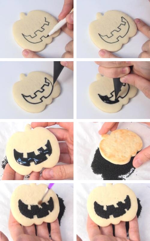 Decorating jack o lantern mouth with black royal icing and black sanding sugar.