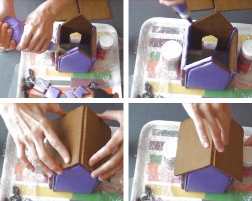 Attaching roof onto a gingerbread house.