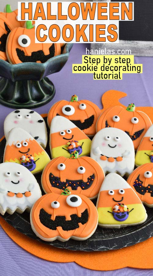 Pumpkin, Ghost and Candy Corn cookies displayed on a black plate.