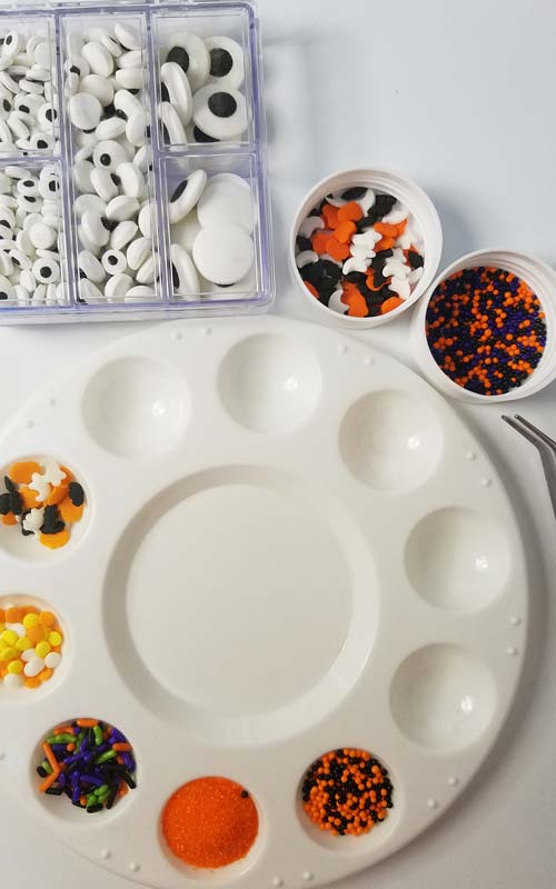 Halloween sprinkles in small bowls.