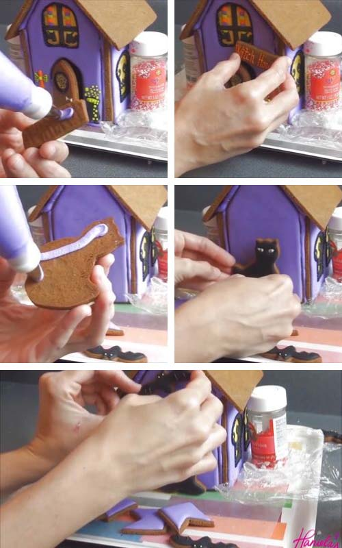 Gluing decorated cookies onto the gingerbread house.