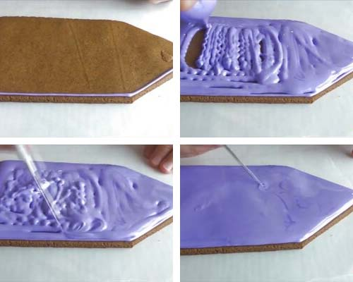 Flooding back panel of gingerbread house with purple icing.