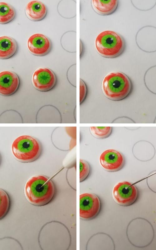 Applying white dot of royal icing onto the eye for reflection.