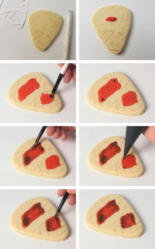 Applying a thin layer of icing onto a cookie with a paint brush.