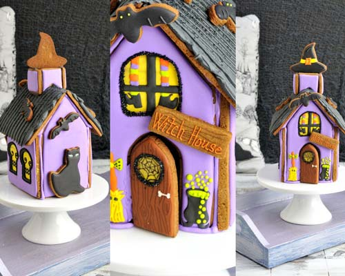 Decorated halloween gingerbread house displayed on a cake stand.